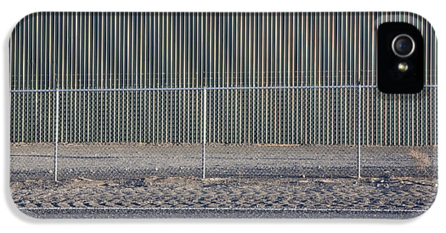Architecture IPhone 5 Case featuring the photograph Metal Storage Shed Behind Fence by Paul Edmondson