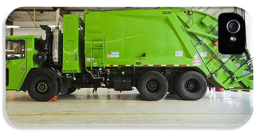 Bay Door IPhone 5 Case featuring the photograph Green Garbage Truck Maintenance by Don Mason