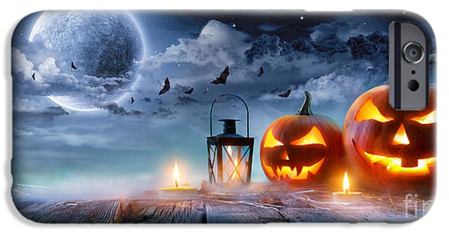 Symbol IPhone 6 Case featuring the photograph Jack O' Lanterns Glowing At Moonlight by Romolo Tavani