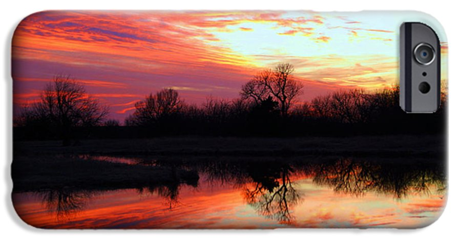 Clouds IPhone 6 Case featuring the photograph Calming Sunset by Larry Keahey
