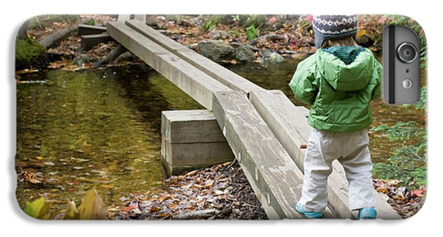 2-3 Years IPhone 6 Plus Case featuring the photograph A Young Girl Walks Across Hiking by Nick Lambert