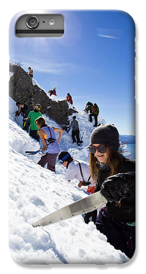 Shovel IPhone 6 Plus Case featuring the photograph Professional Skier Using A Snow Saw by Ben Girardi