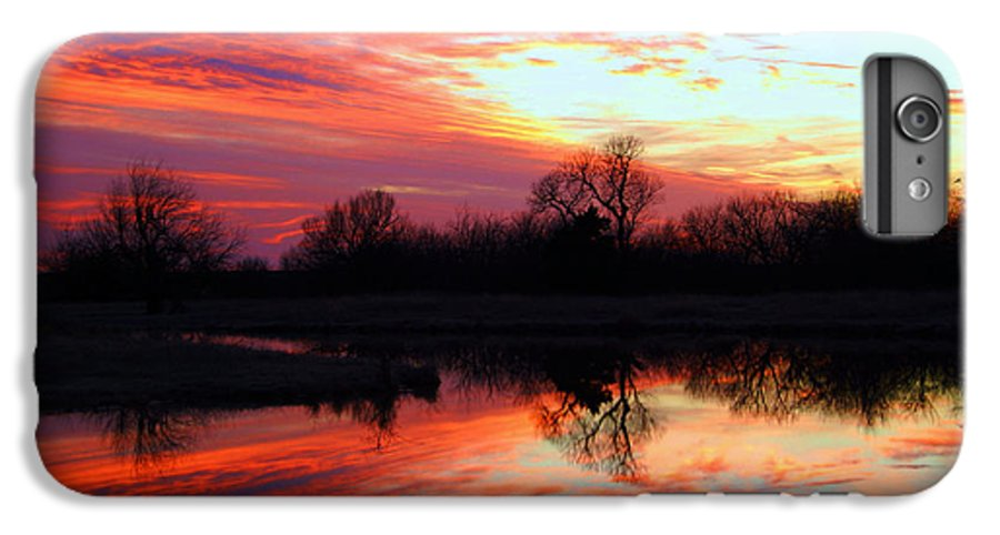 Clouds IPhone 6 Plus Case featuring the photograph Calming Sunset by Larry Keahey