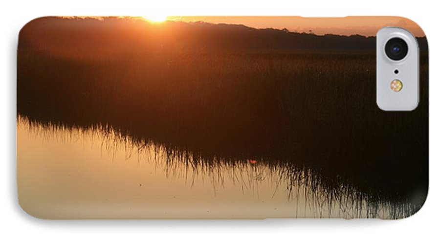 Sunrise IPhone 7 Case featuring the photograph Autumn Sunrise Over The Marsh by Nadine Rippelmeyer
