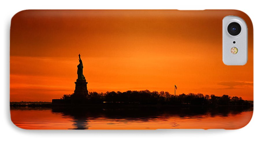 New York Skyline IPhone 7 Case featuring the photograph Statue Of Liberty At Sunset by John Farnan