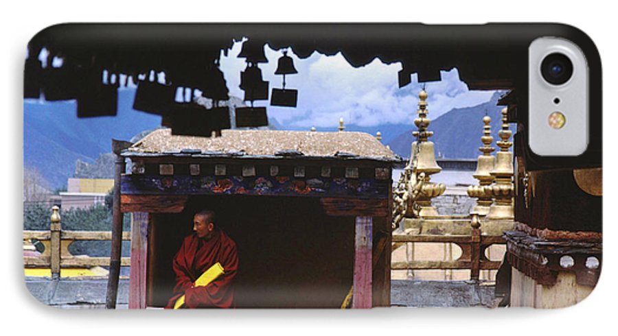 Tibet IPhone 7 Case featuring the photograph Tibetan Monk With Scroll On Jokhang Roof by Anna Lisa Yoder