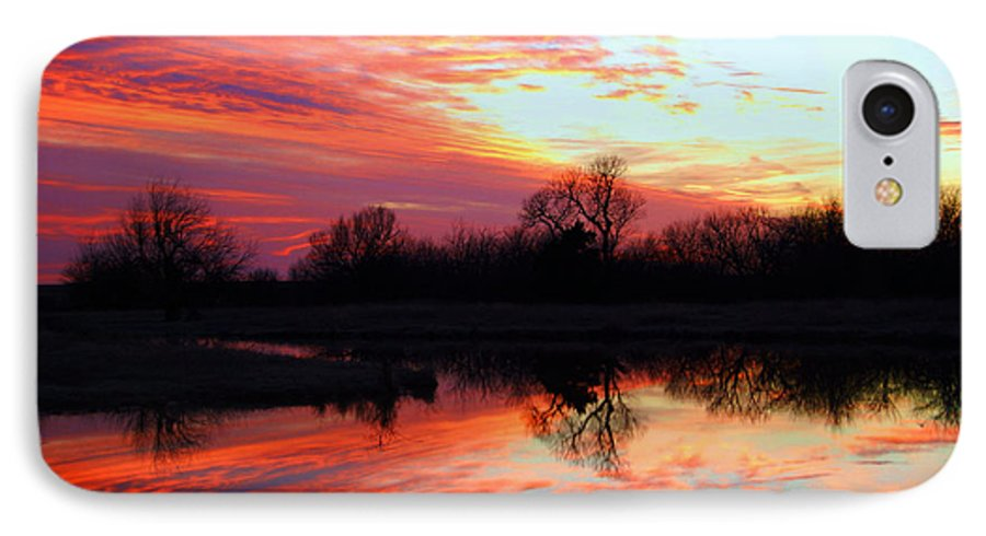 Clouds IPhone 7 Case featuring the photograph Calming Sunset by Larry Keahey