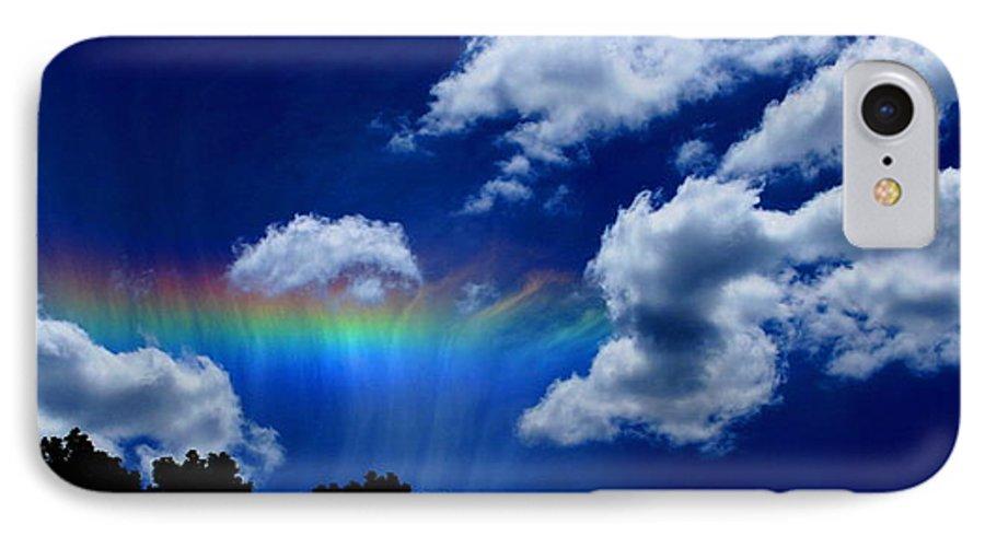Heavens Rainbow IPhone 7 Case featuring the photograph Heavens Rainbow by Linda Sannuti