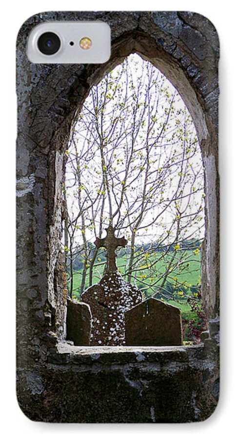 Ireland IPhone 7 Case featuring the photograph Looking Out Fuerty Church Roscommon Ireland by Teresa Mucha