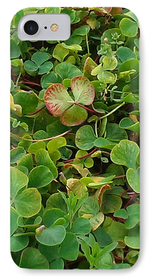 Shamrock IPhone 7 Case featuring the photograph Lucky Charms by Colleen Cornelius