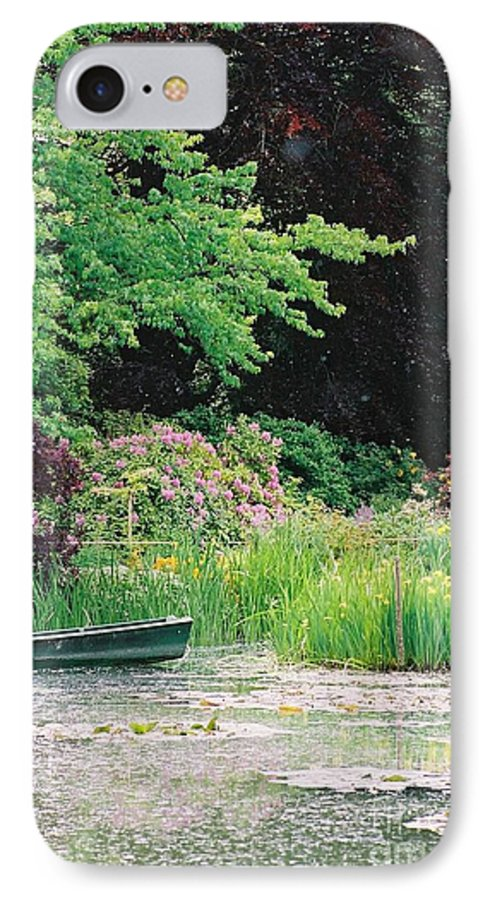 Monet IPhone 7 Case featuring the photograph Monet's Garden Pond And Boat by Nadine Rippelmeyer