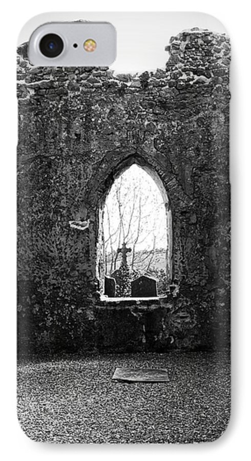 Ireland IPhone 7 Case featuring the photograph Window At Fuerty Church Roscommon Ireland by Teresa Mucha