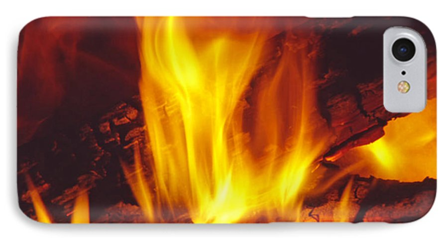 Fire IPhone 7 Case featuring the photograph Wood Stove - Blazing Log Fire by Steve Ohlsen