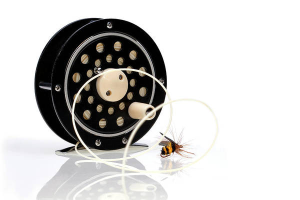 Black Poster featuring the photograph Fly Fishing Reel With Fly by Tom Mc Nemar