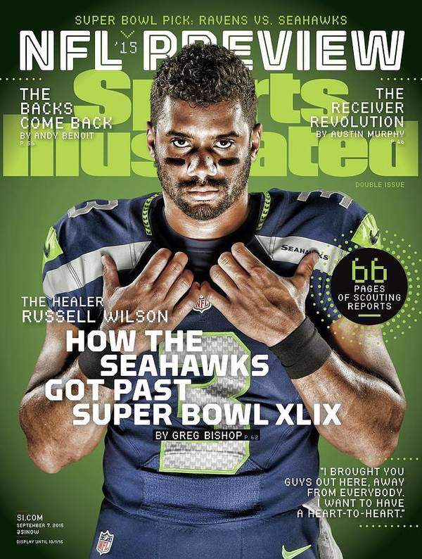 Magazine Cover Poster featuring the photograph The Healer Russell Wilson 2015 Nfl Football Preview Issue Sports Illustrated Cover by Sports Illustrated