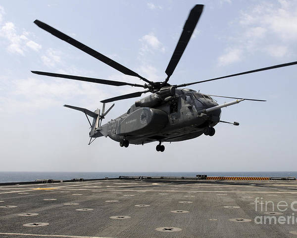 Military Poster featuring the photograph An Mh-53e Sea Dragon Prepares To Land by Stocktrek Images
