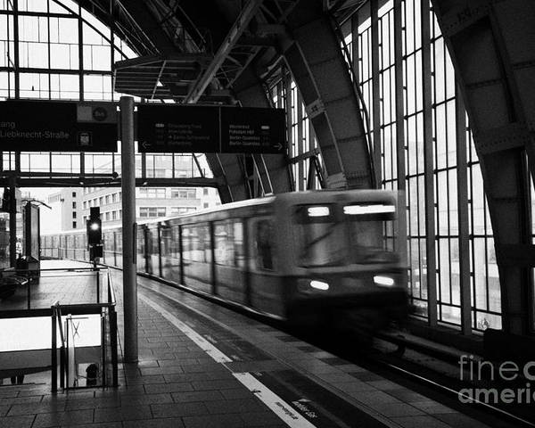Berlin Poster featuring the photograph Berlin S-bahn Train Speeds Past Platform At Alexanderplatz Main Train Station Germany by Joe Fox