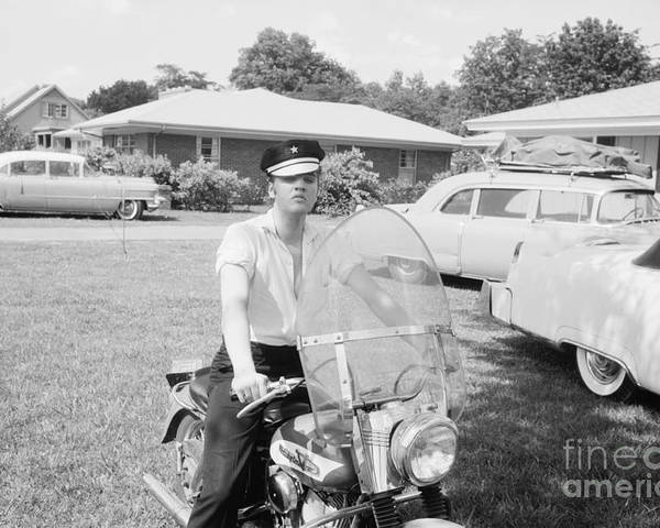 Elvis Presley Poster featuring the photograph Elvis Presley sitting on his 1956 Harley KH by The Harrington Collection