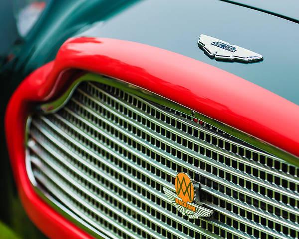 1960 Aston Martin Db4 Gt Coupe' Grille Emblem Poster featuring the photograph 1960 Aston Martin Db4 Gt Coupe' Grille Emblem by Jill Reger