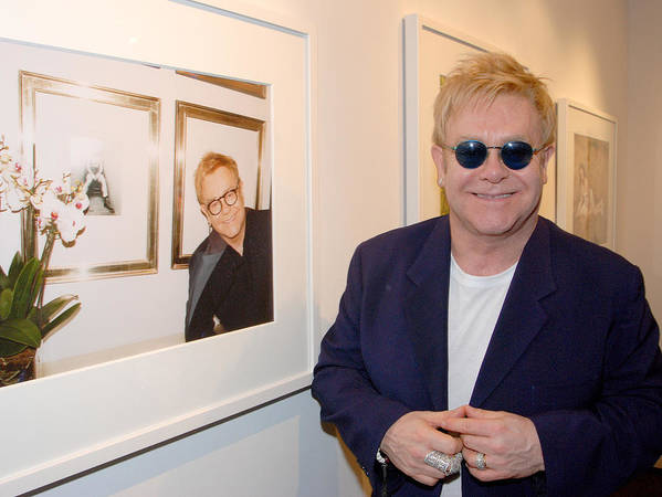 Celebrity Poster featuring the photograph Elton watching Elton by Philip Shone