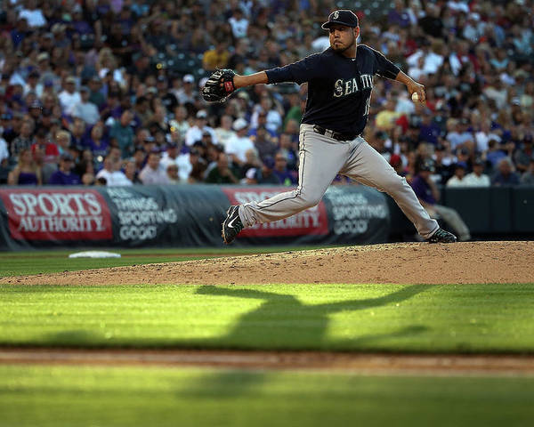 People Poster featuring the photograph Seattle Mariners V Colorado Rockies by Doug Pensinger