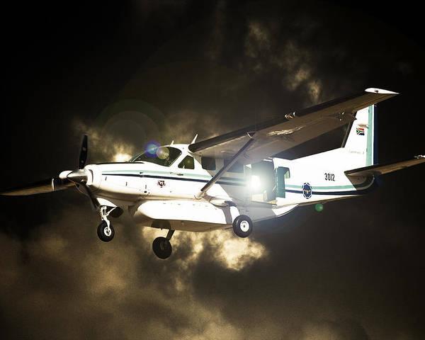 Cessna 208 Caravan Poster featuring the photograph 208 Light by Paul Job