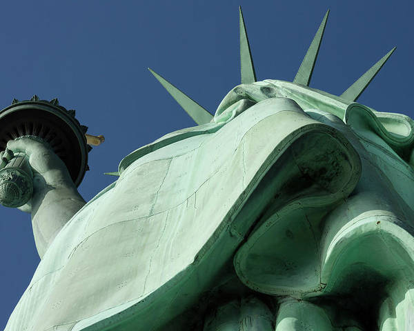 Photography Poster featuring the photograph Low Angle View Of Statue Of Liberty by Panoramic Images
