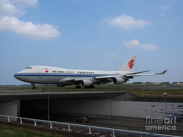 737 Poster featuring the photograph Air China Cargo Boeing 747 by Paul Fearn