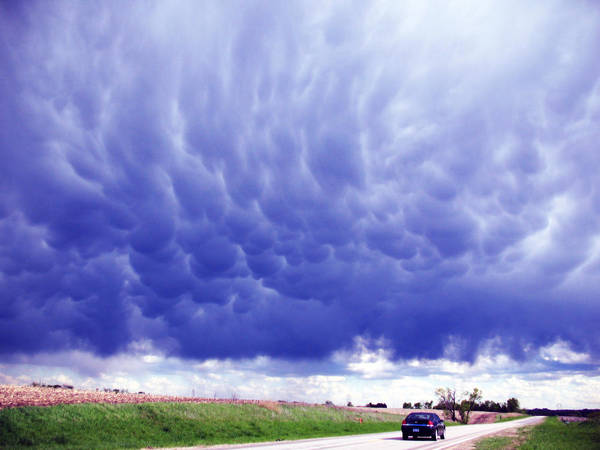 Nebraska Poster featuring the photograph A Rural Nebraska Highway And Magnificent Sky by Tyler Robbins