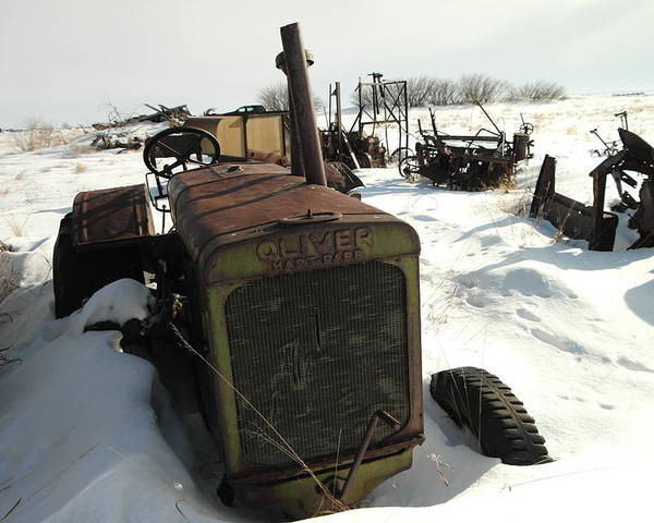 Tractors Poster featuring the photograph A Tractor In The Snow by Jeff Swan