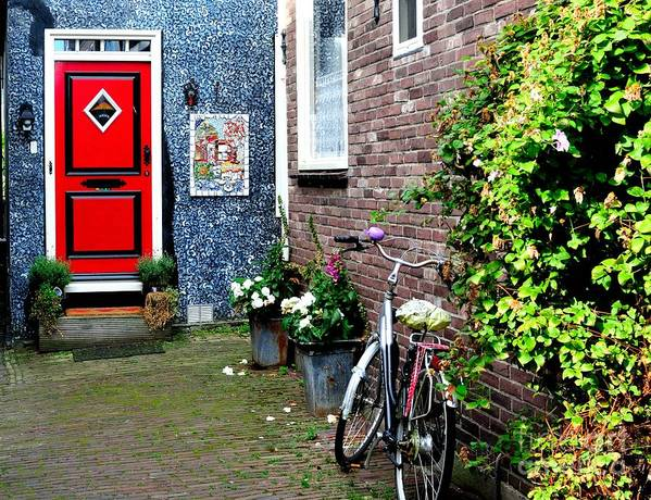Red Poster featuring the photograph Alleyway In Dutch Village by Joe Ng