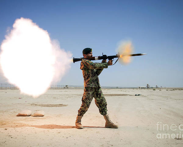 Coalition Forces Poster featuring the photograph An Afghan National Army Soldier Fires by Stocktrek Images