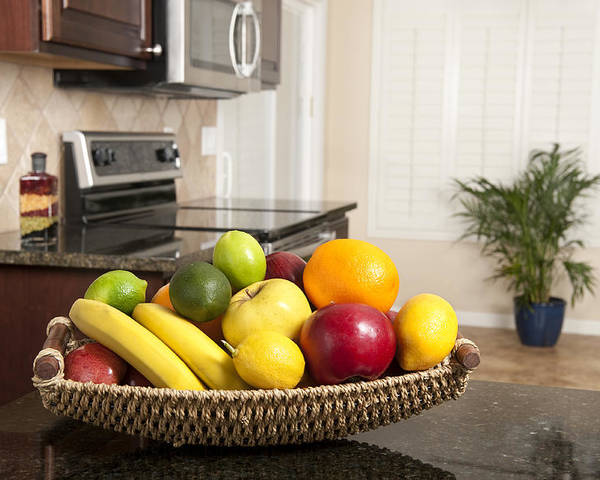 Kitchen Poster featuring the photograph Basket Of Fresh Fruit In Modern Kitchen by Joe Belanger