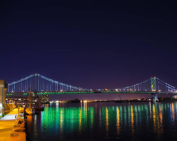 Benjamin Poster featuring the photograph Benjamin Franklin Bridge At Night From Penn's Landing by Bill Cannon