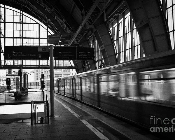 Berlin Poster featuring the photograph Berlin S-bahn Train Speeds Past Platform At Alexanderplatz Main Train Station Germany by Joe Fox