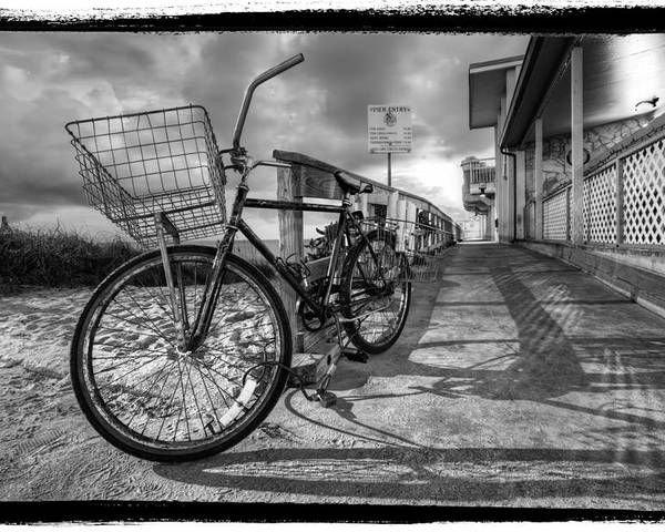 Clouds poster featuring the photograph black and white beach bike by debra and dave vanderlaan