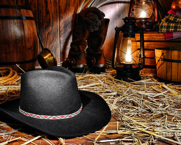 Western Poster featuring the photograph Black Cowboy Hat In An Old Barn by Olivier Le Queinec
