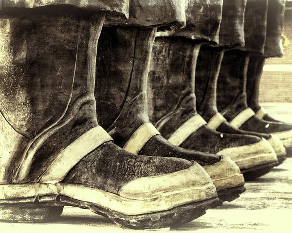 Joan Carroll Poster featuring the photograph Boots On The Ground Monotone by Joan Carroll