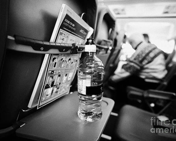 Interior Poster featuring the photograph Bottle Of Water On Tray Table Interior Of Jet2 Aircraft Passenger Cabin In Flight Europe by Joe Fox
