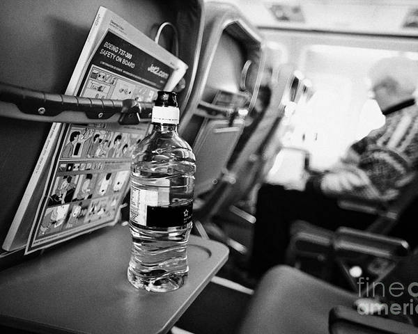 Interior Poster featuring the photograph Bottle Of Water On Tray Table Interior Of Jet2 Aircraft Passenger Cabin In Flight by Joe Fox