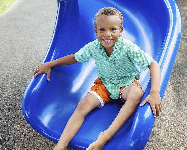 Blue Poster featuring the photograph Boy On Slide by Kicka Witte