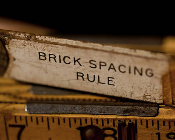 Rusty Poster featuring the photograph Brick Mason's Rule by Wilma Birdwell