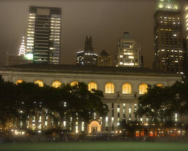 Bryant Park In New York City At Night Poster featuring the photograph Bryant Park In New York City At Night by Michael Dagostino