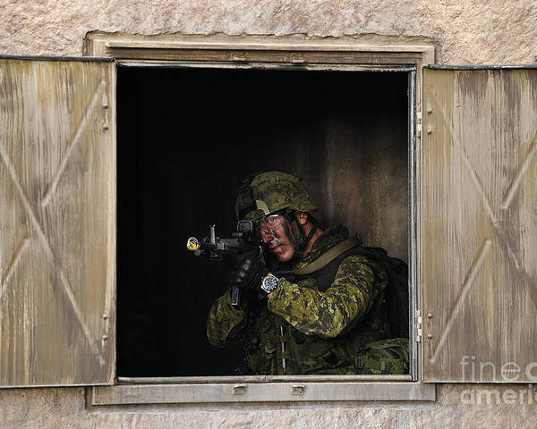 Military Poster featuring the photograph Canadian Army Soldier Conducts Military by Stocktrek Images