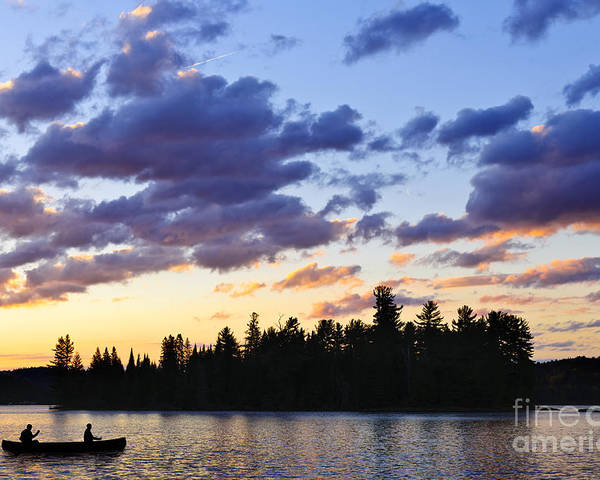 Sunset Poster featuring the photograph Canoeing At Sunset by Elena Elisseeva