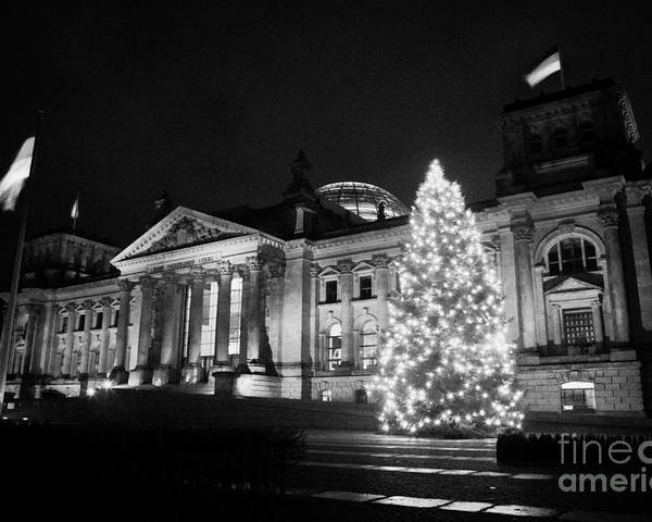 Berlin Poster featuring the photograph christmas tree and german flag flying fluttering on flagpole outside reichstag building Berlin Germany by Joe Fox