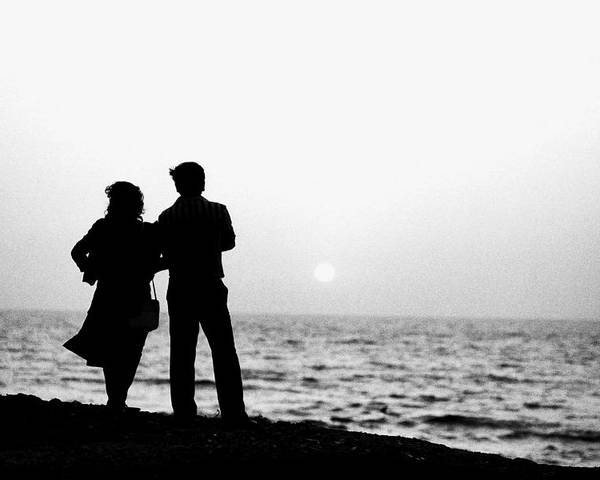 1986 Poster featuring the photograph Couple Looking Out To Sea by Jagdish Agarwal