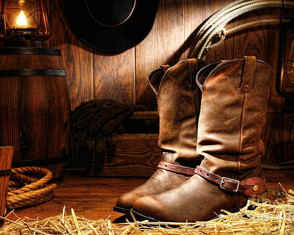 Western Poster featuring the photograph Cowboy Boots In A Ranch Barn by Olivier Le Queinec