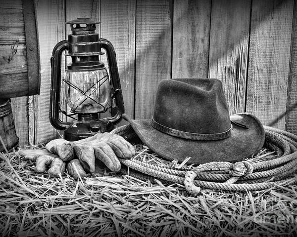 Barn Poster featuring the photograph Cowboy Hat And Rodeo Lasso In A Black And White by Paul Ward