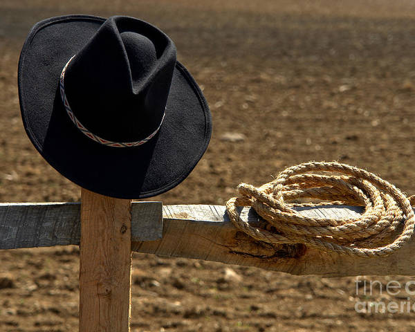 Western Poster featuring the photograph Cowboy Hat And Rope On Fence by Olivier Le Queinec